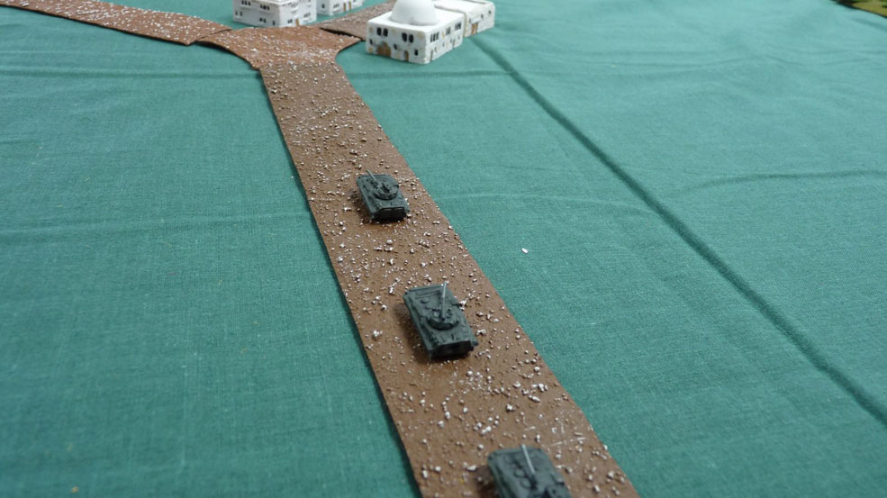 A platoon of BMPs drive to the central hamlet