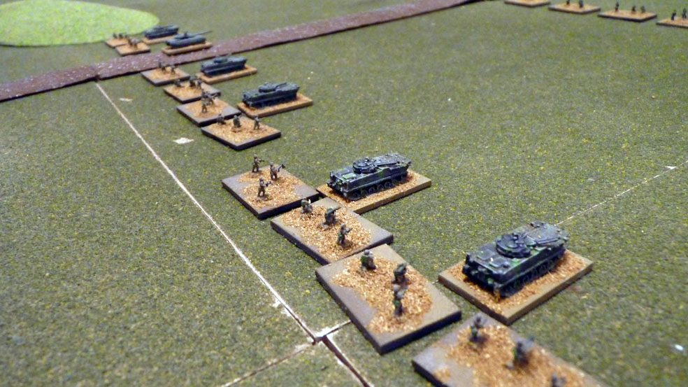 Chinese infantry advance supported by armoured vehciles
